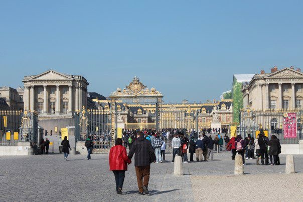 People standing in the courtyard of the Palace of Versailles