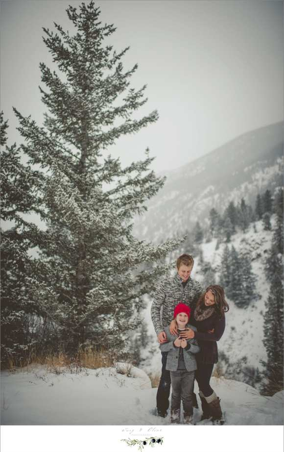happy family session, snowy colorado day, trees, beautiful backdrop
