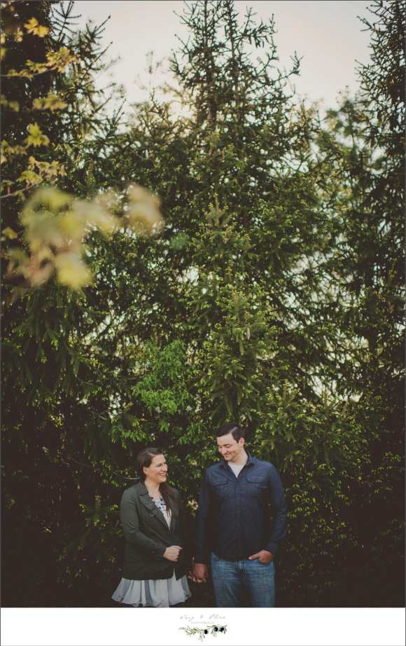 Fort Wayne backdrop, trees, happy couples