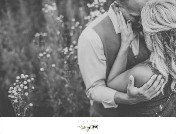 black and white engagement sessions, flowers, greenery, Rustic Manor Delafield WI, happy couple
