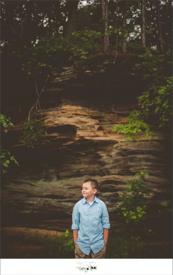 growing up too fast, rocks, rocky outcroping, blue shirt
