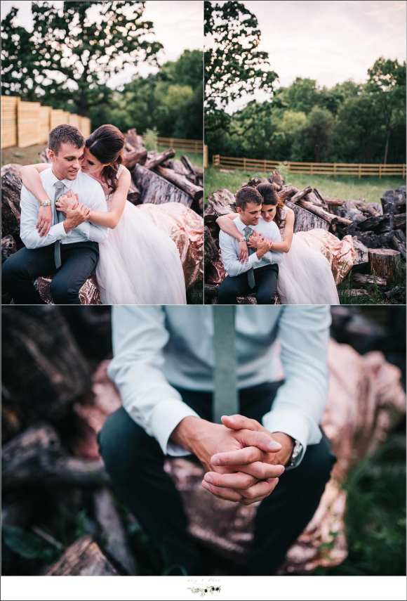 wedding posing on log pile