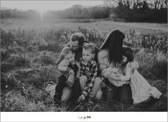 black and white family in a field