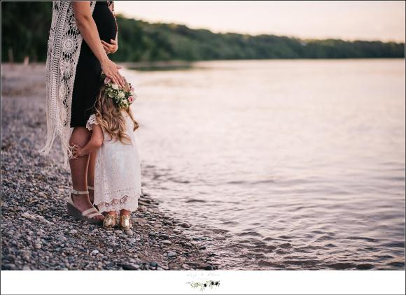 Mother and daughter by the lake