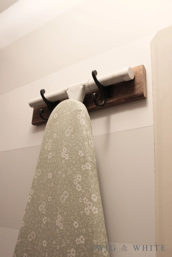 simple diy ironing board hanger for the laundry room