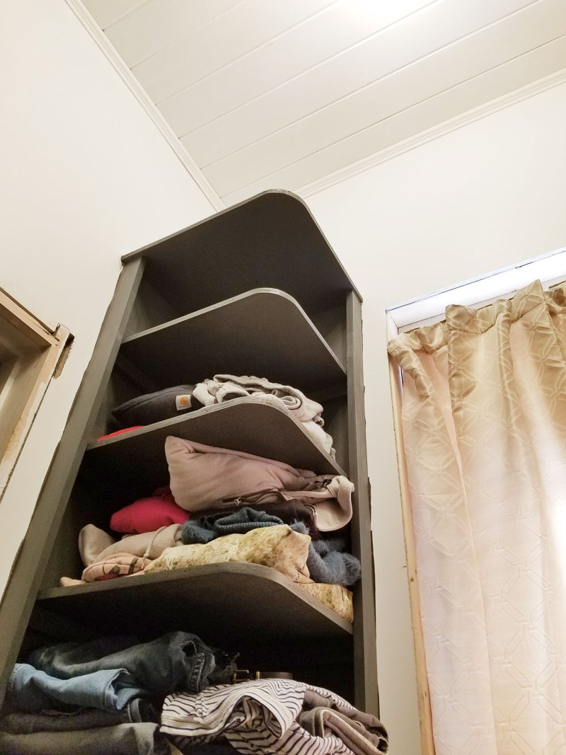 painted shelving in walk-in closet