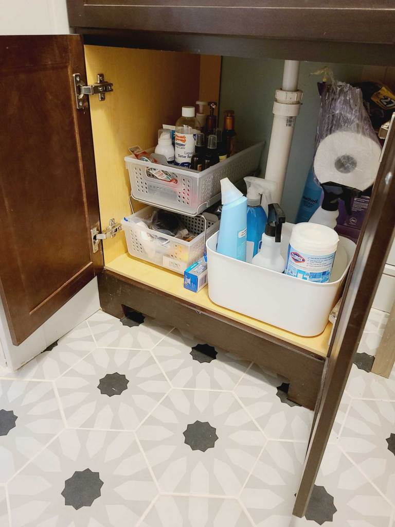 bathroom sink organizing with storage containers