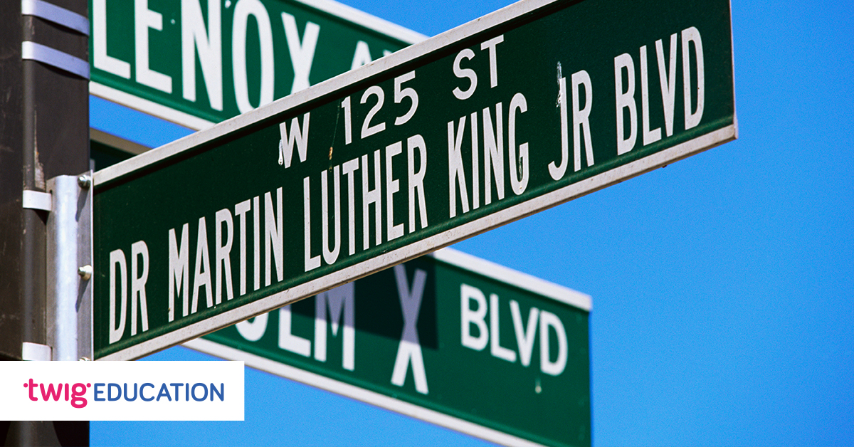 "Street sign of ""Dr Martin Luther King Jr Blvd"" against blue sky"