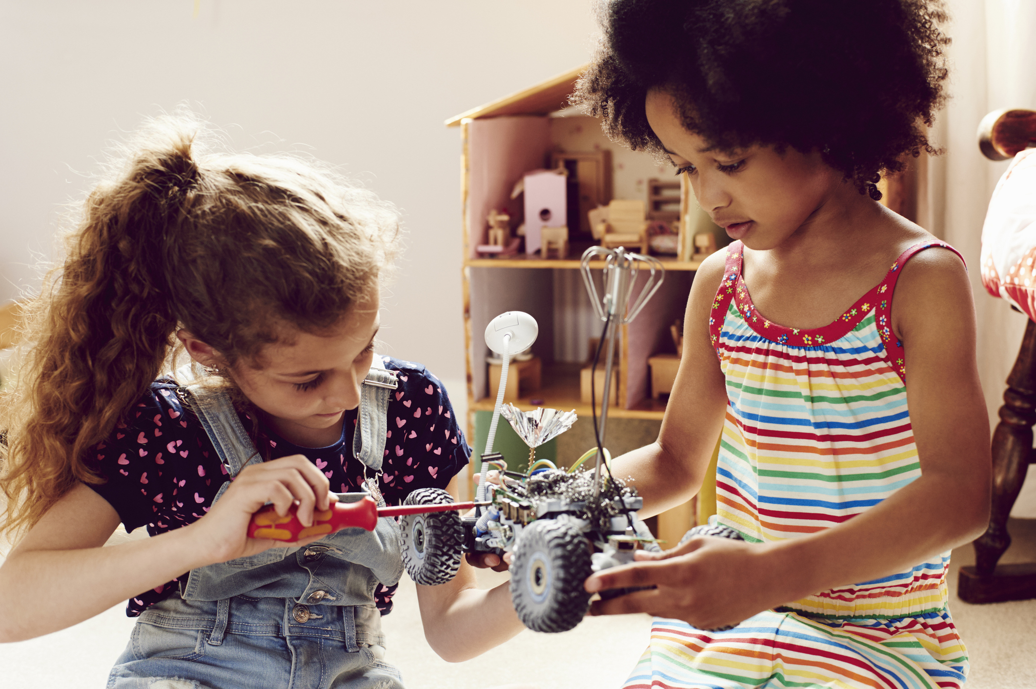Two children working together to make things