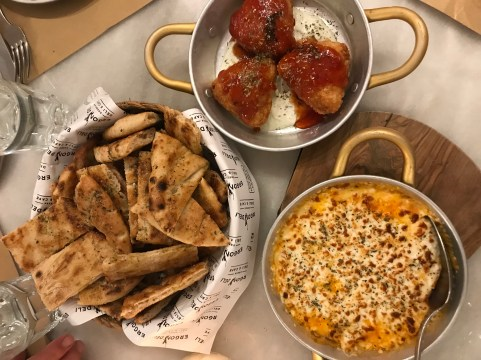 pita breads, tirokafteri, and pastourmadopitakia