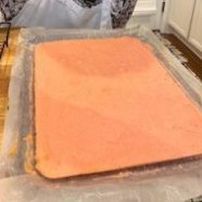 Add apricot preserves between first 2 layers