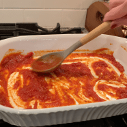 Lightly drizzle EVOO then spread small amount of tomato sauce to lightly cover bottom of casserole dish