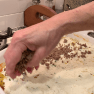 Sprinkle half the meat mixture over ricotta mixture