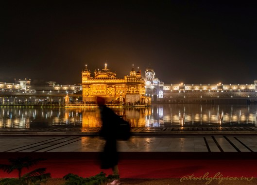 A Khalsa Walking By the Temple Complex