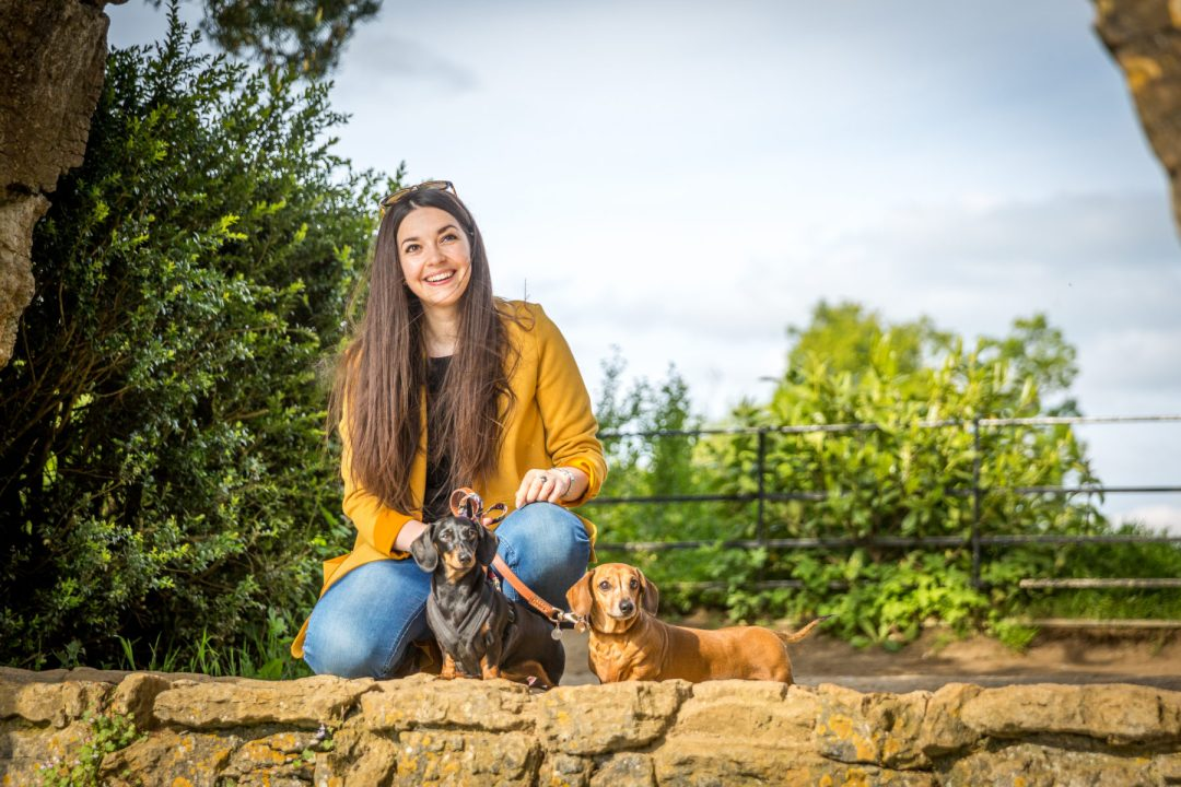 Click to discover why the National Trust dog walks at Stowe make an incredible day out with your dog. Picture shows our two dachshunds & Sarah Baxter from Twilight Bark UK at the Cascade at Stowe.