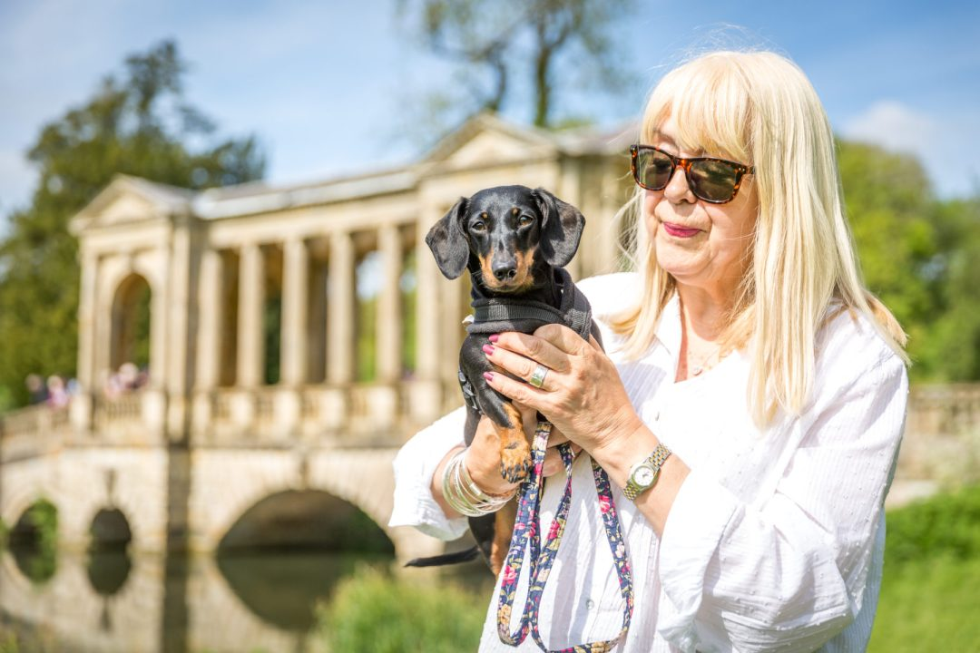 Click to discover why the National Trust dog walks at Stowe make an incredible day out with your dog. Picture shows Millie from Twilight Bark UK & my Mum at Palladian Bridge.