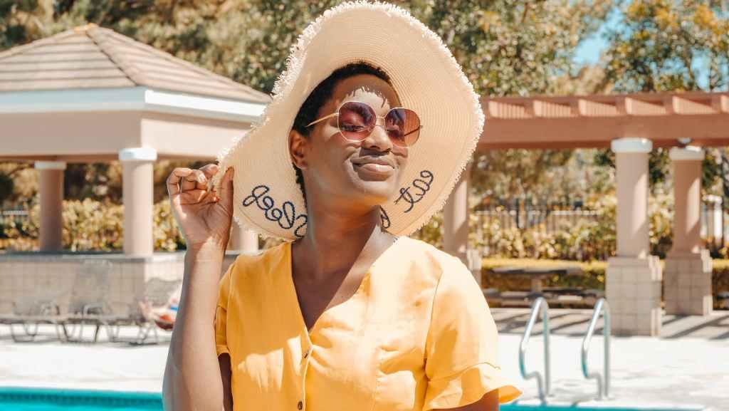 woman wearing sun hat and sunglasses