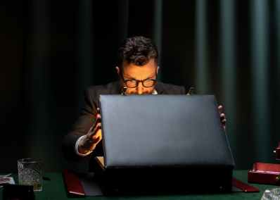 man in black long sleeve shirt using black laptop computer. greed is the enemy of self-care