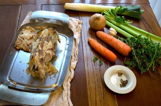 ingredients for chicken stock; chicken carcass, vegetables, herbs, seasoning
