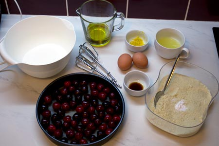 Ingredients for a gluten and dairy free lemon cherry cake.