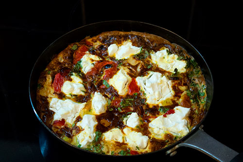 roasted peppers and goat's cheese frittata on stove