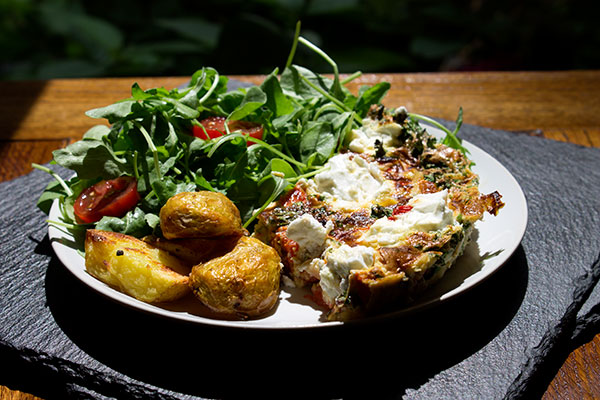 Roasted Peppers and Goat's Cheese Frittata with a bit of salad and some roast potatoes