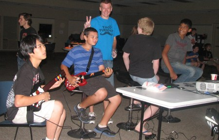 Teens of different racial backgrounds playing video games. Photo by Pioneer Library System.