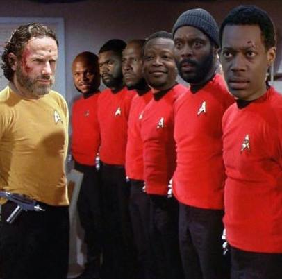 Rick Grimes as Captain Kirk standing in front of a line of T Dog, the nameless guy from the prison, Father Gabriel, Bob, Tyreese and Noah all wearing red shirts.