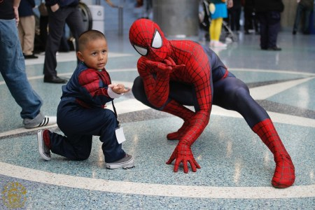 little boy and spider-man cosplayer