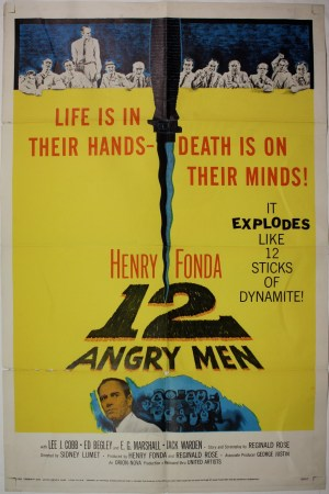 "Original theatrical poster for 12 Angry Men, featuring the tagline ""Life is in their hands—death is on their minds! It explodes like 12 sticks of dynamite!"""