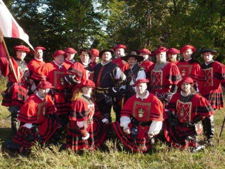 A group photo of the Royal Guard in their red wool uniforms