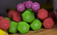 a pile of multi-colored dumbbells