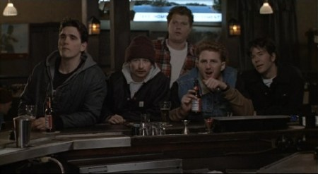The five main characters. It's clearly winter as they each have jackets on. THey are sitting at the bar staring off at who knows what after some comment is made.