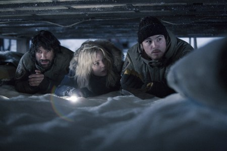 Bennett, George, and Hartnett are hiding in the crawl space under a house with a flashlight and plenty of snow.