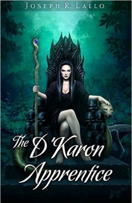 Cover of the D'Karon Apprentice: Top reads Joseph R Lallo and the Bottom script shows The D'Karon Apprentice. The picture is of a woman sitting in a thrown with a staff. She's clad in black with long black hair. The backgorund is greenish, forested, some light.