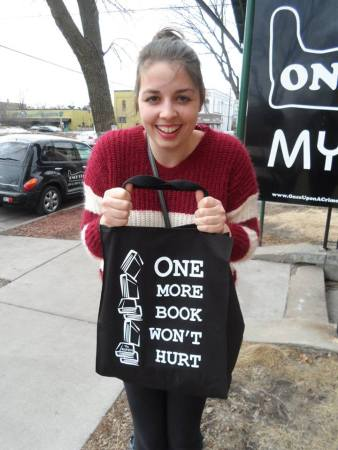 Me happily carrying my Once Upon a Crime tote outside of the bookstore.