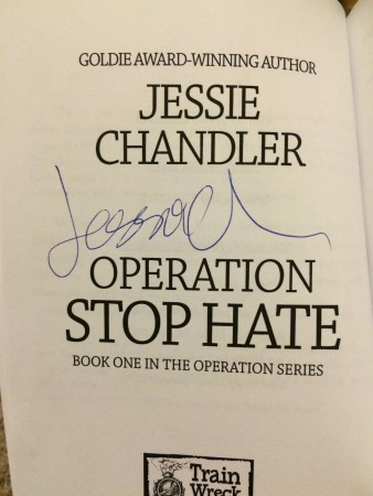 Photo of Operation Stop Hate's title page with Jessie Chandler's autograph.