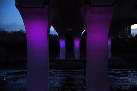 Purple lights on Minneapolis 35W bridge over the Mississippi in honor of Prince