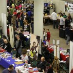 A photo look down at the crowd and tables of Minneapolis Comic Con.
