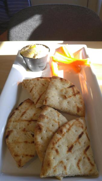 House-made hummus with pita bread and carrots.