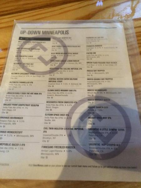 List of a menu titled Up-Down on the top. Details different beers on tap including a Pineapple Cider.