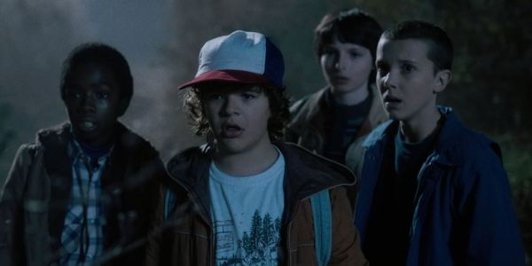 Lucas, Dustin, Mike, and Eleven looking shocked