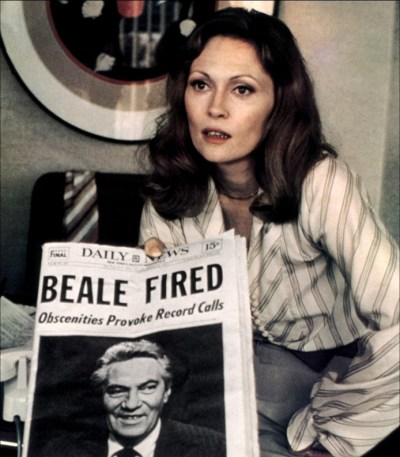 Faye Dunaway holding newspaper in Network.