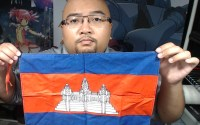 Author holds a Cambodian flag.