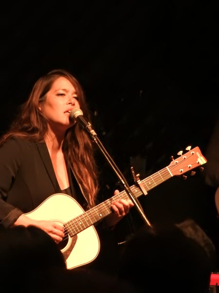 Rachel Yamagata singing and playing her guitar