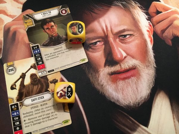 Dice, cards, and an image of Obi-Wan Kenobi