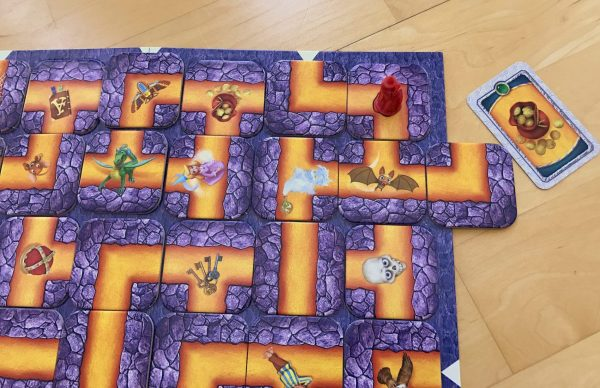 A close up of the board with an example on how to shift the maze to reach a goal
