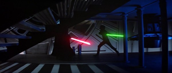 Darth Vader and Luke Skywalker battling with lightsabers.