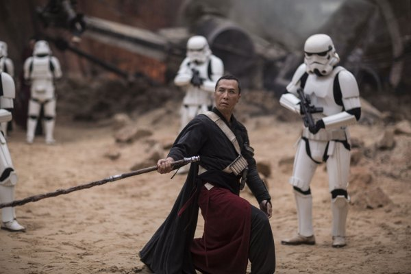 Chirrut Imwe confronts a squad of Stormtroopers