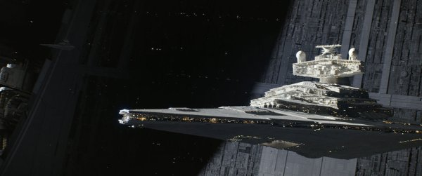 An Imperial Star Destroyer moves across the surface of the Death Star